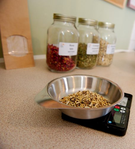 Weighing dried herbs